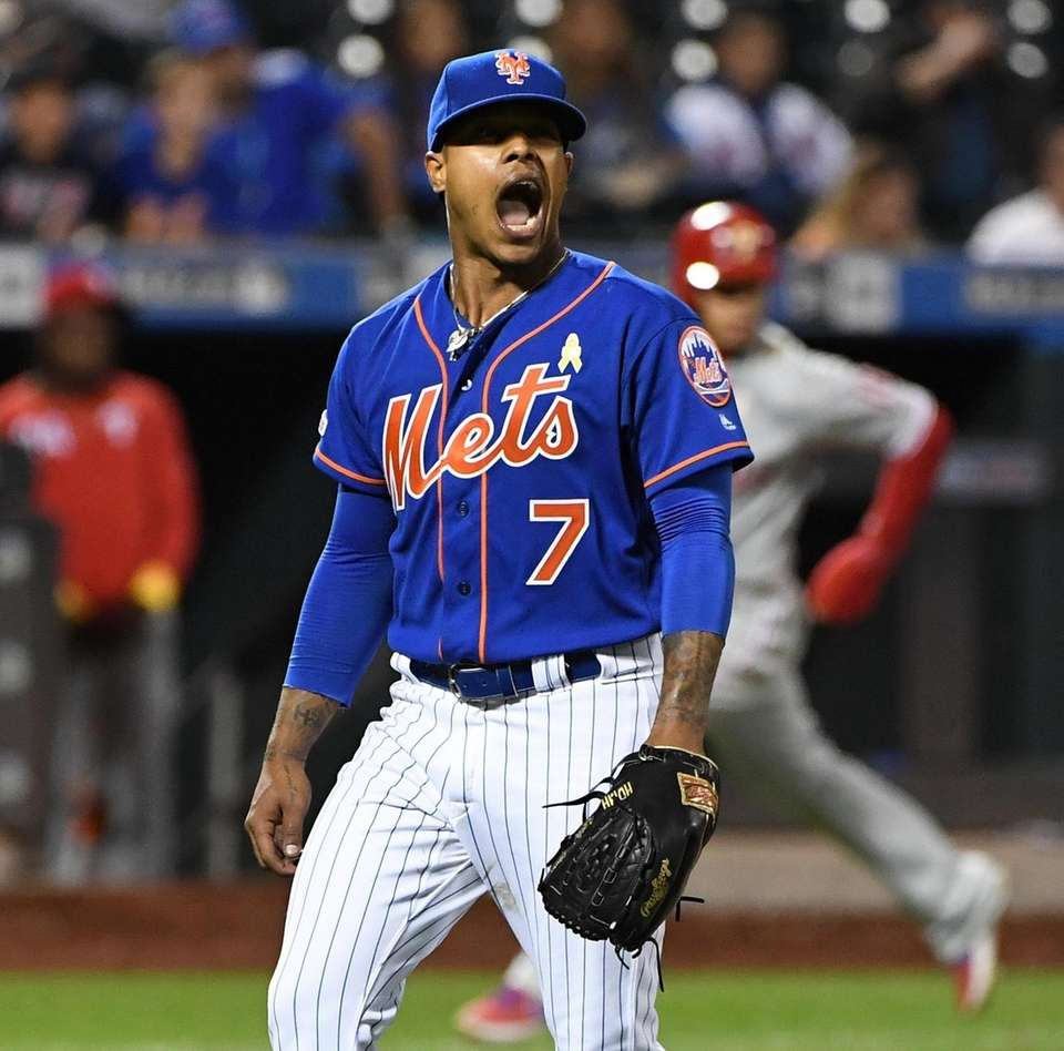 New York Mets starting pitcher Marcus Stroman reacts