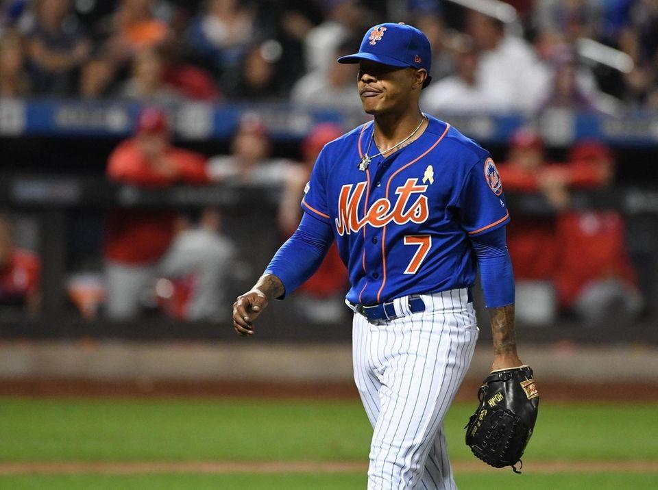New York Mets starting pitcher Marcus Stroman walks