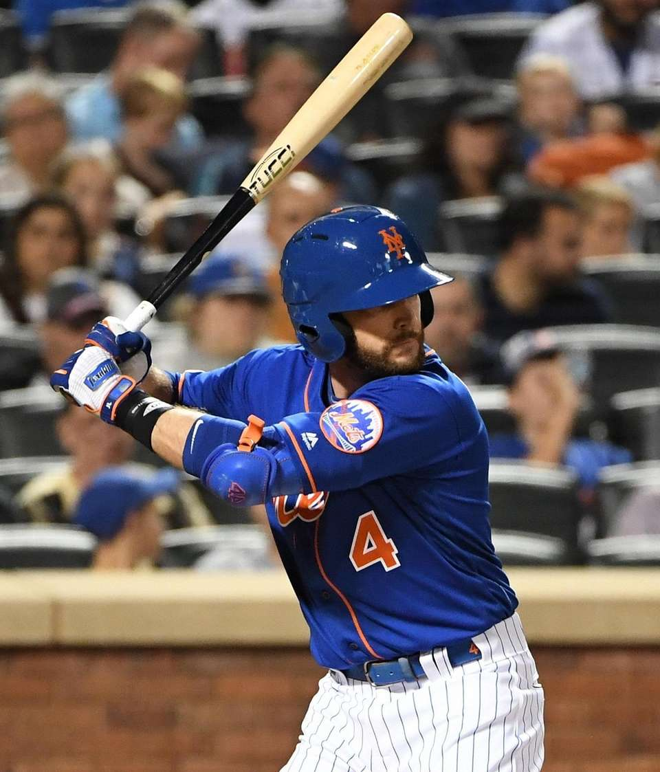New York Mets pinch hitter Jed Lowrie looks