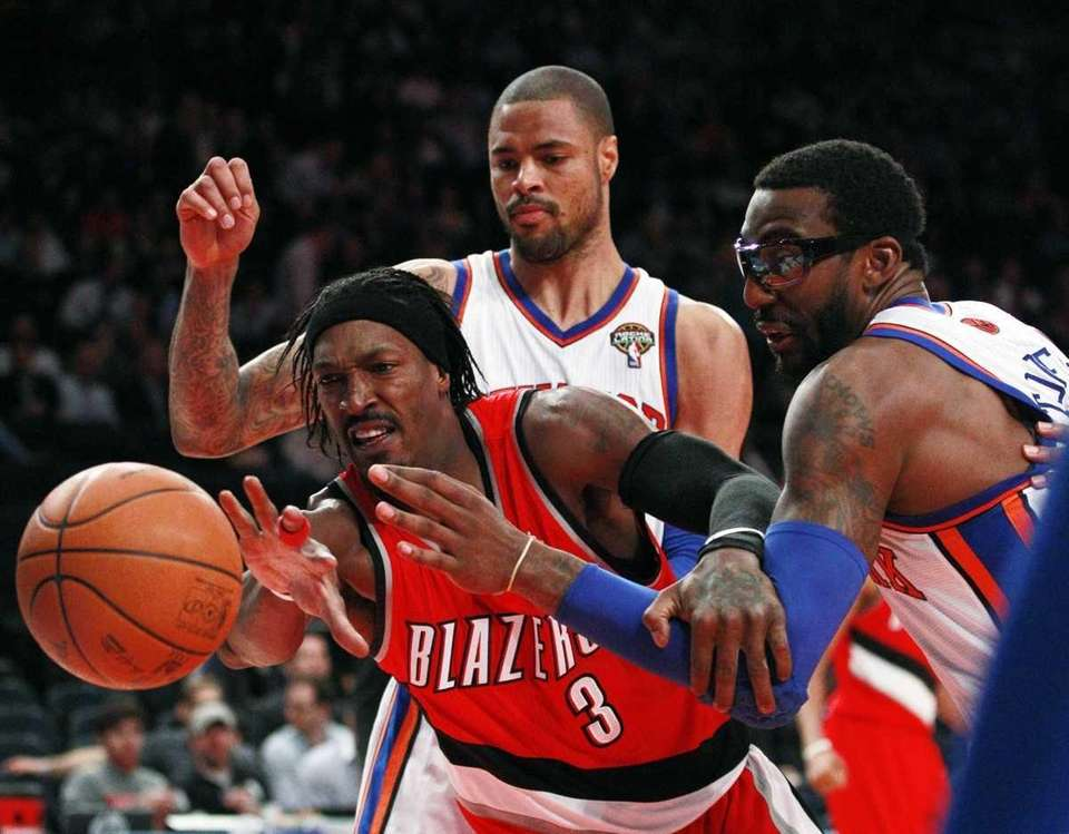 Portland Trail Blazers' Gerald Wallace (3) is defended