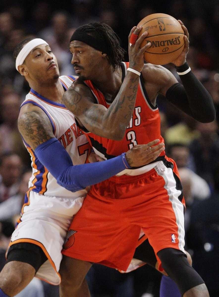 New York Knicks' Carmelo Anthony, left, guards Portland