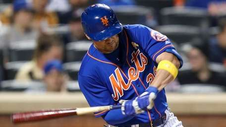 The Mets' J.D. Davis hits a single during