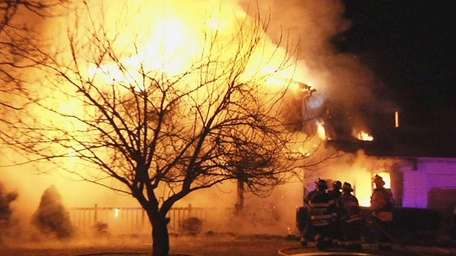 Setauket firefighters battle an early morning blaze at