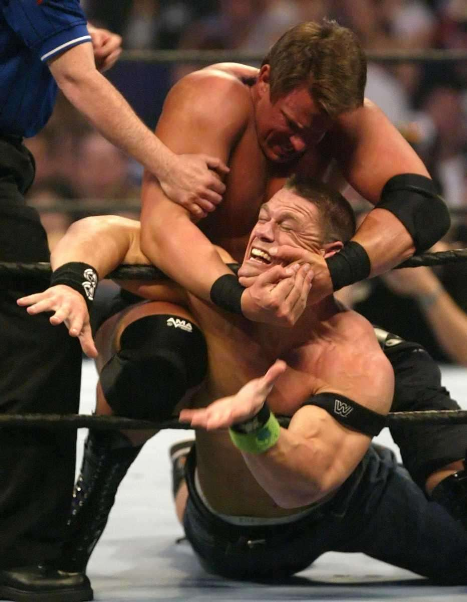 John Bradshaw Layfield puts a choke hold on