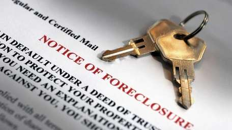 House keys and foreclosure notice. iStochphoto.com