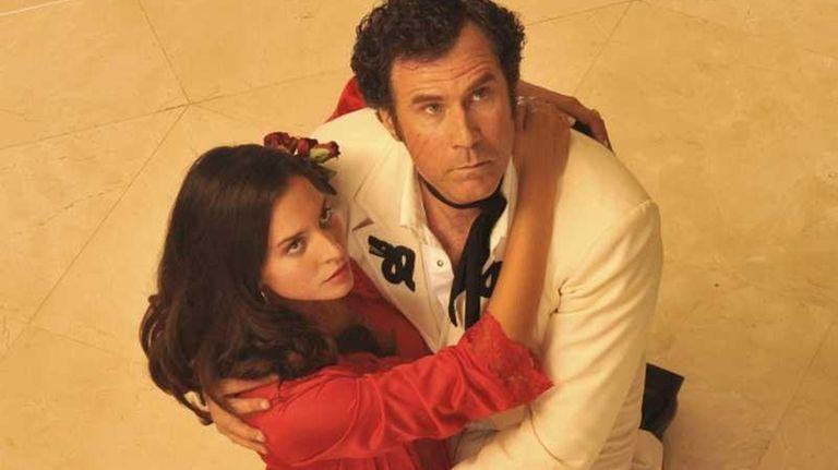 Sonia (Genesis Rodriguez) and Armando (Will Ferrell) in