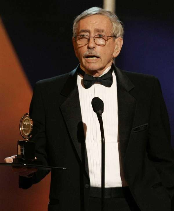 Playwright Edward Albee holds his Tony Award for
