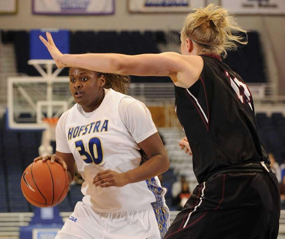Hofstra forward Shante Evans moves to get past