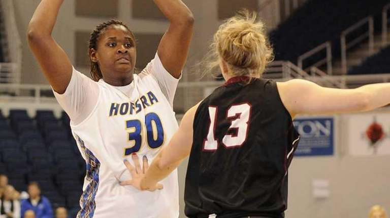 Hofstra forward Shante Evans looks to pass as