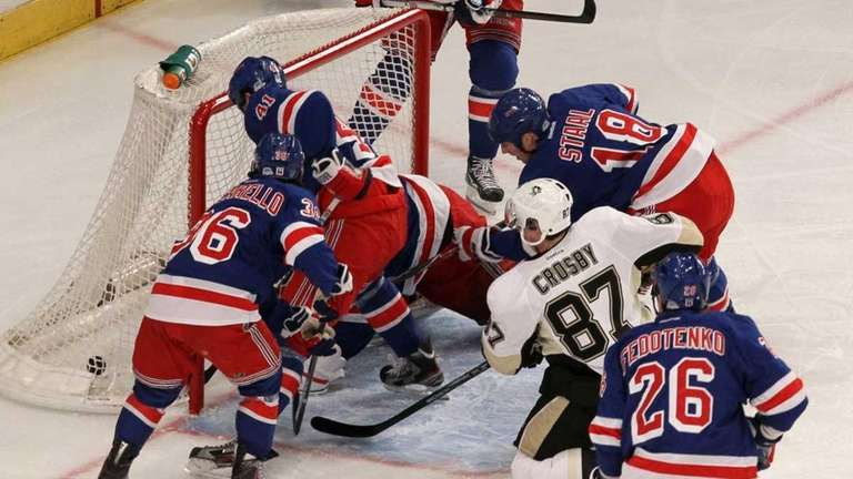 Sidney Crosby of the Pittsburgh Penguins watches the