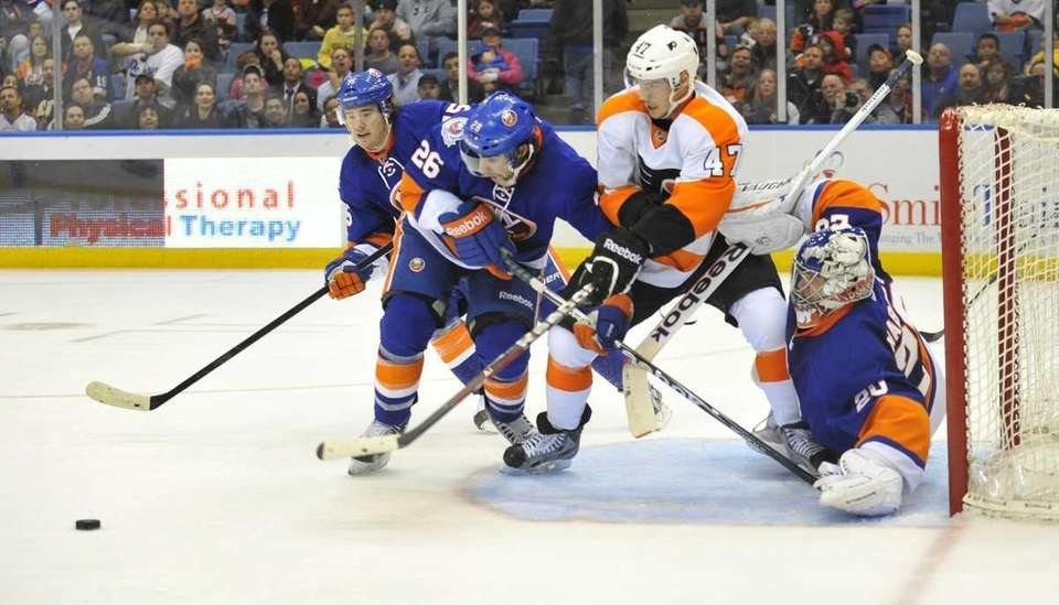 Islanders goalie Evgeni Nabokov tries to move Eric