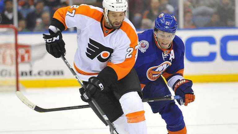 Maxime Talbot of the Flyers skates past Kyle