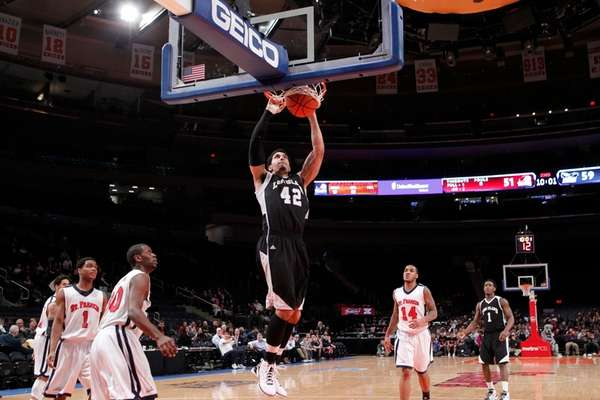 LIU Brooklyn's Julian Boyd dunks in a game