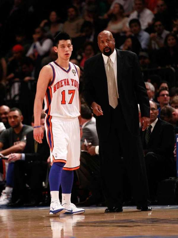 Knicks interim head coach Mike Woodson talks with