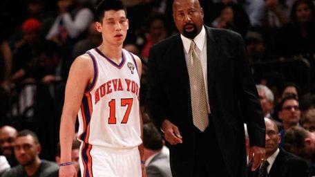 Knicks interim head coach Mike Woodson talks with