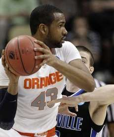 Syracuse's James Southerland looks to pass around UNC-Asheville's