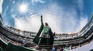 Jets super fan Jet Man looks on during