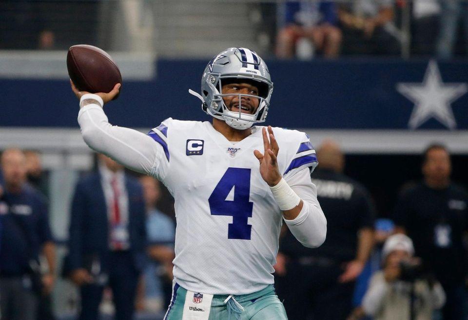 Cowboys quarterback Dak Prescott throws a pass in
