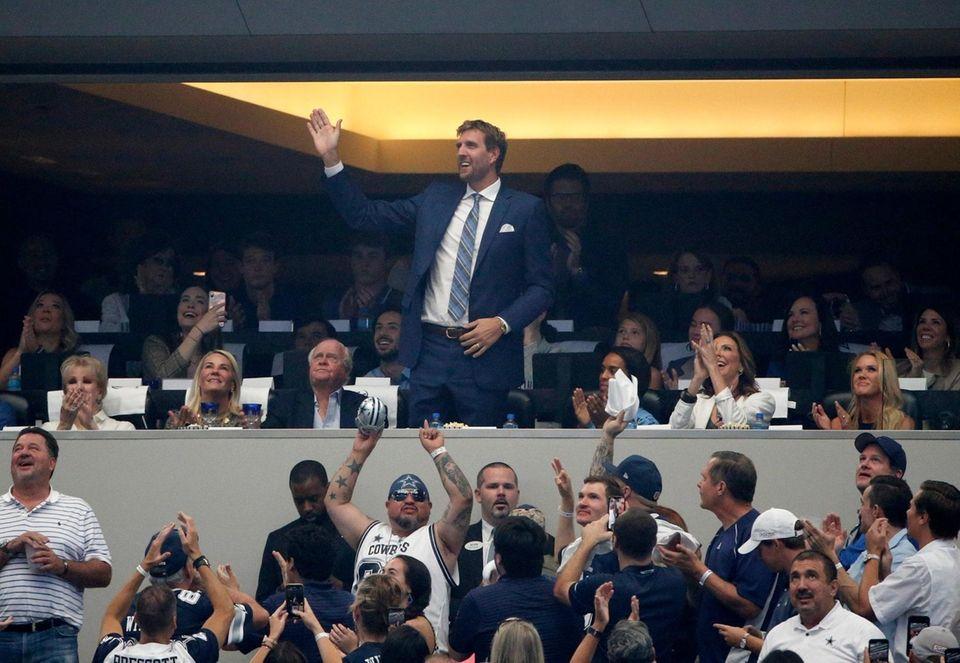Former Dallas Mavericks player Dirk Nowitzki acknowledges cheers