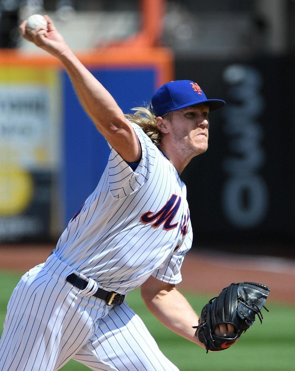 New York Mets starting pitcher Noah Syndergaard delivers