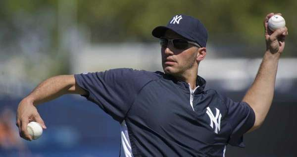 Andy Pettitte throws batting practice to the Yankees