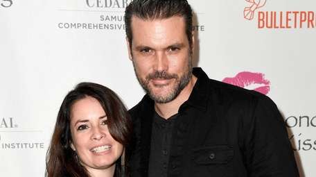 Holly Marie Combs and Mike Ryan attend the