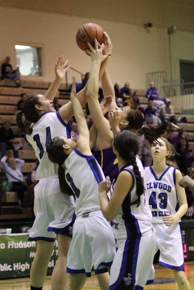 Elwood/John Glenn's Allison McKenna jumps high to grab