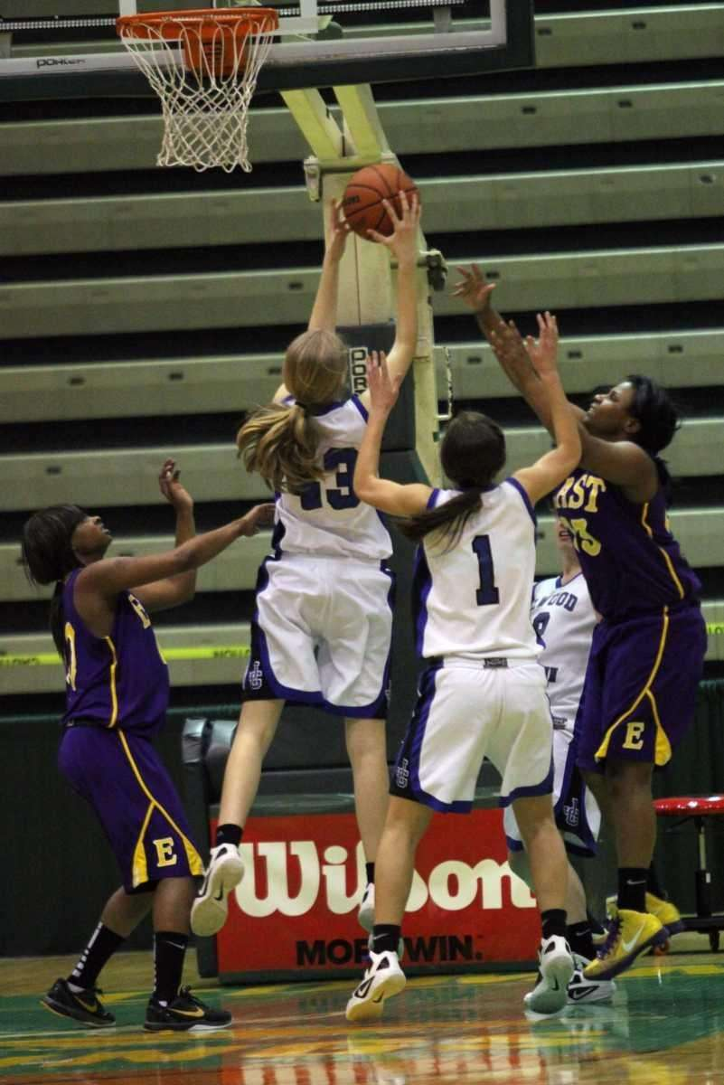 Elwood/John Glenn's Lexie Koenke goes up for a