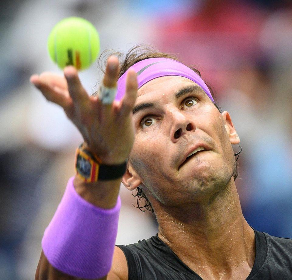 Rafael Nadal of Spain serving in the 1st