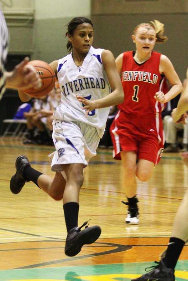 Riverhead's Melodee Riley dribbles down the court past