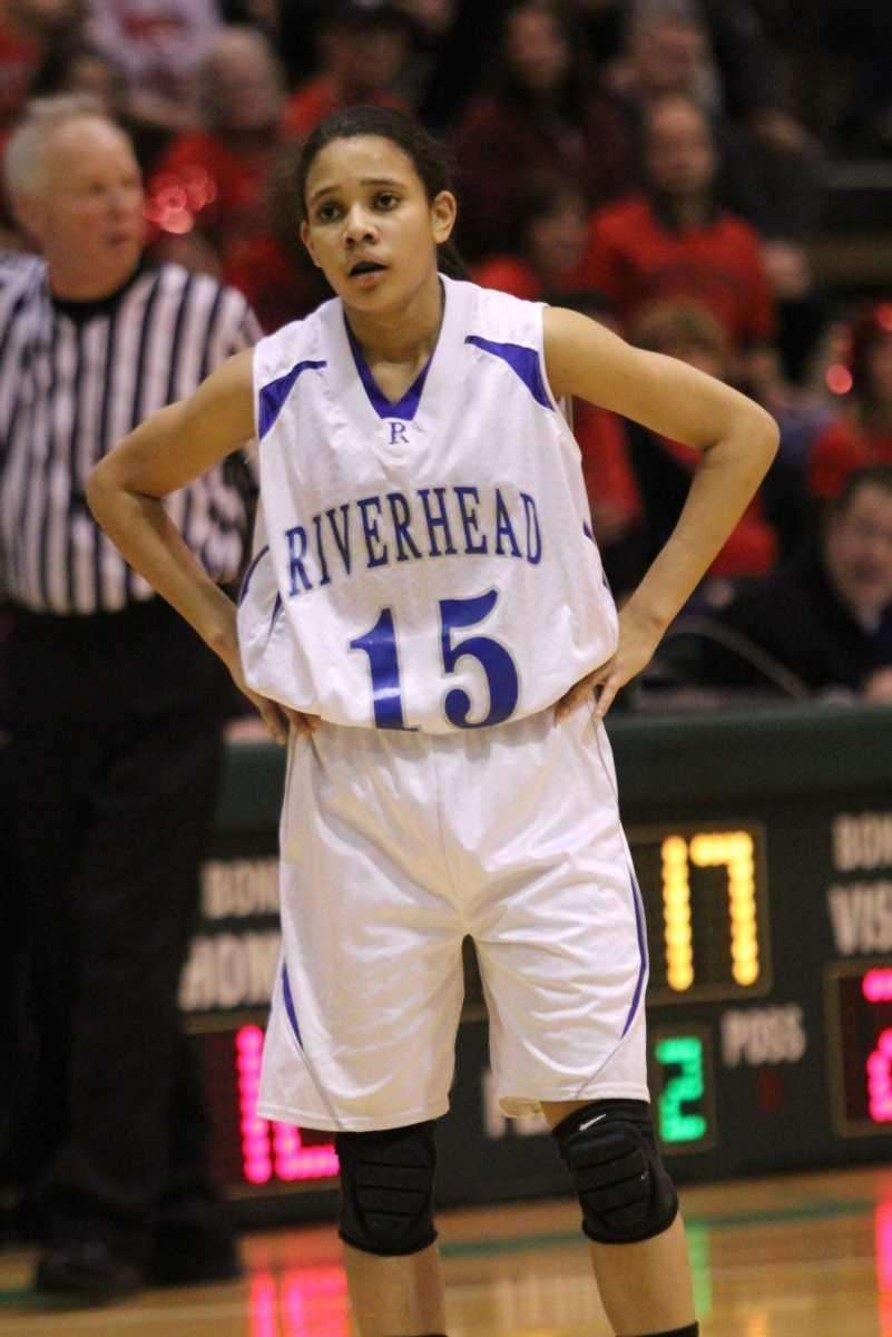 Riverhead's Jalyn Brown looks to a referee after