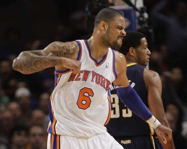 Knicks' Tyson Chandler reacts as Indiana Pacers' Danny