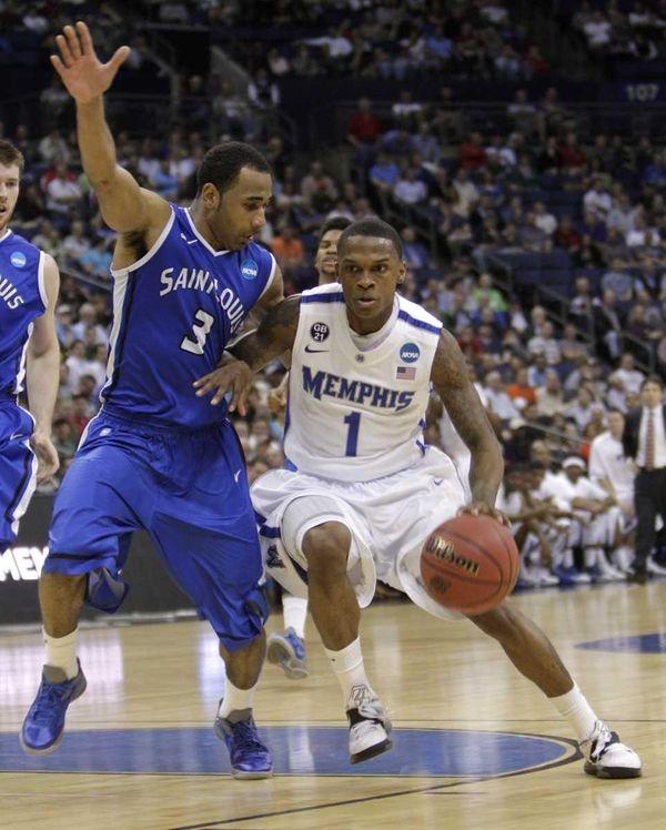 Memphis' Joe Jackson drives to the basket as