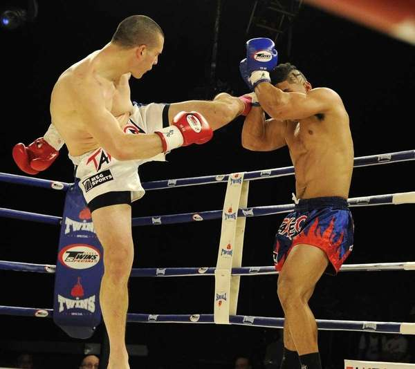 Steven Hernandez, left, throws a roundhouse kick to