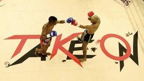 Rudy Felix, left, fights Cornel Ward, right ,