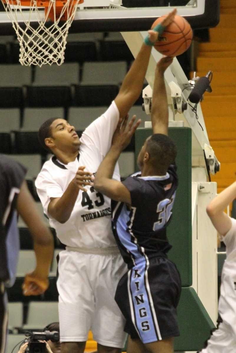 Harborfield's Chris Brady blocks a shot by Bishop