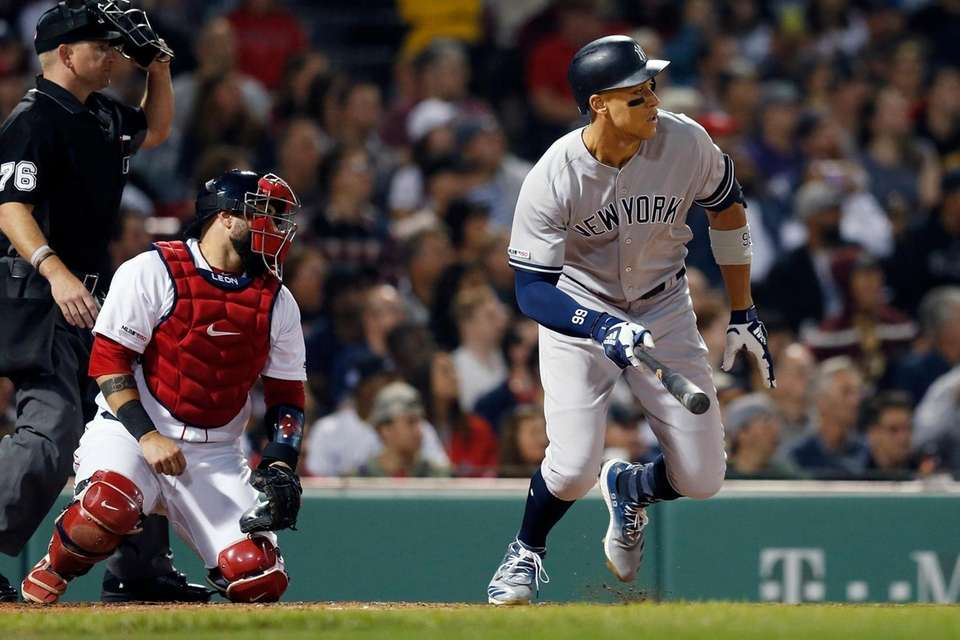 The Yankees' Aaron Judge, right, watches his RBI-single