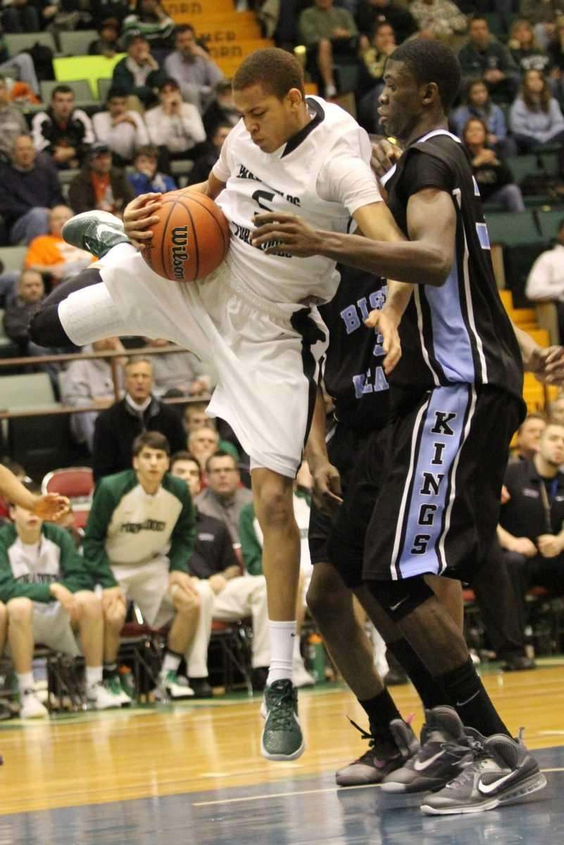 Harborfields High School's David Ba grabs the ball