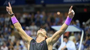 Rafael Nadal reacts after defeating Daniil Medvedev in