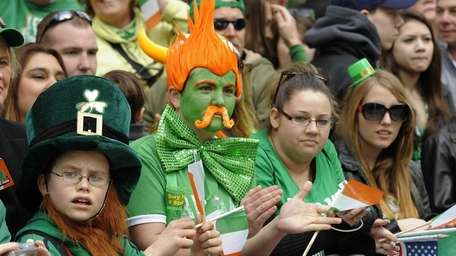 Parade-goers watch the 251st St. Patrick's Day Parade