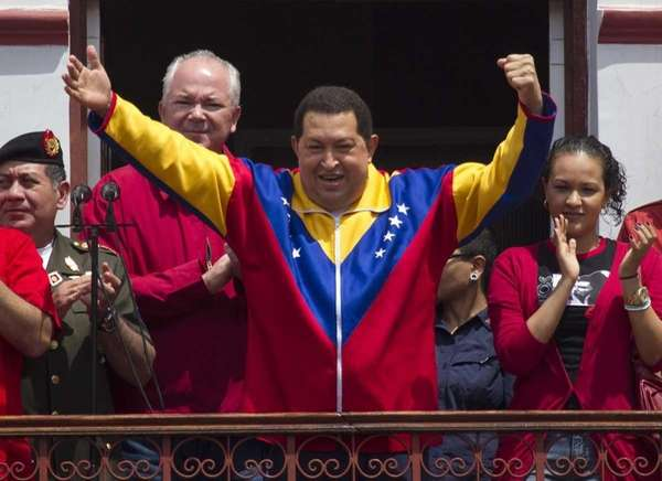 Venezuelan President Hugo Chavez greets supporters from a