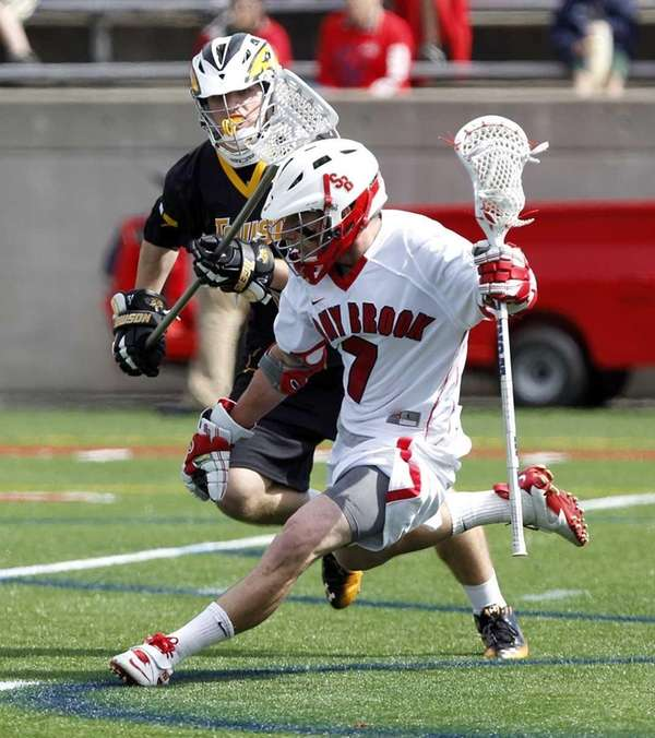 Stony Brook's Nick Watson (7) drives against Towson's