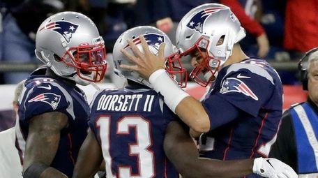 Patriots quarterback Tom Brady, right, celebrates his touchdown
