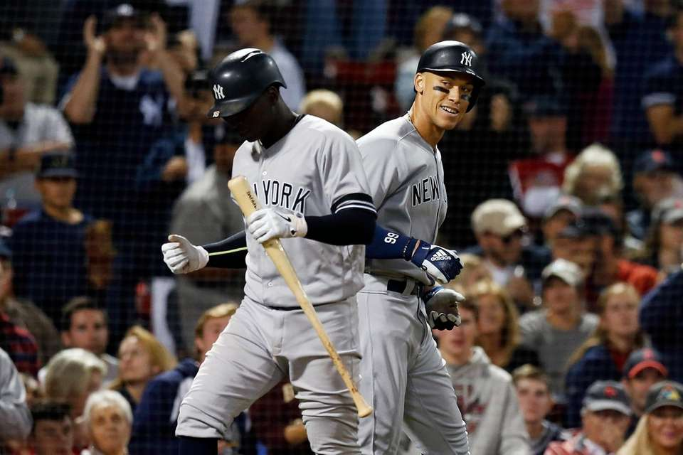 The Yankees' Aaron Judge, right, celebrates his solo