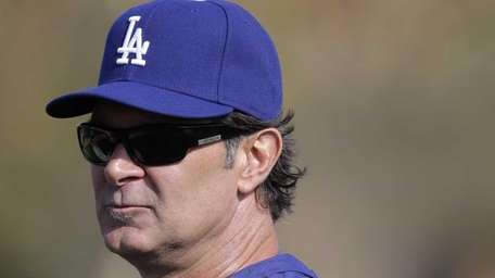 Los Angeles Dodgers manager Don Mattingly watches during