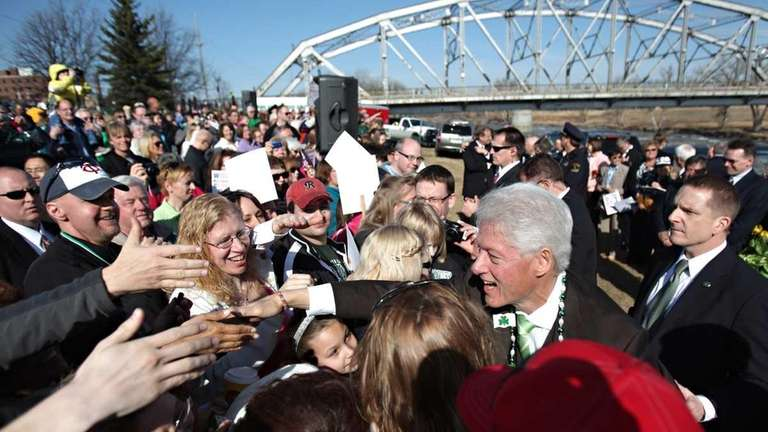 Former President Bill Clinton greets a crowd in