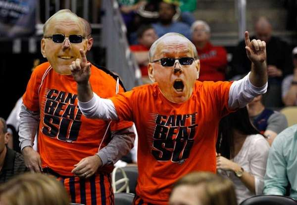 Fans of the Syracuse Orange wear giant masks