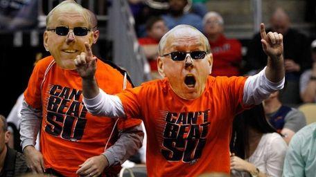 Fans of the Syracuse Orange wear giant masks