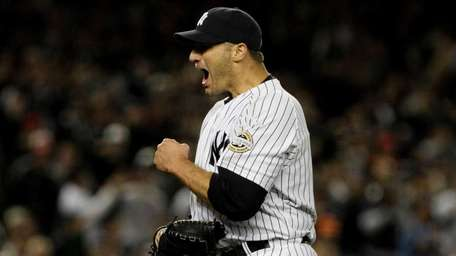 Andy Pettitte celebrates the end of the top