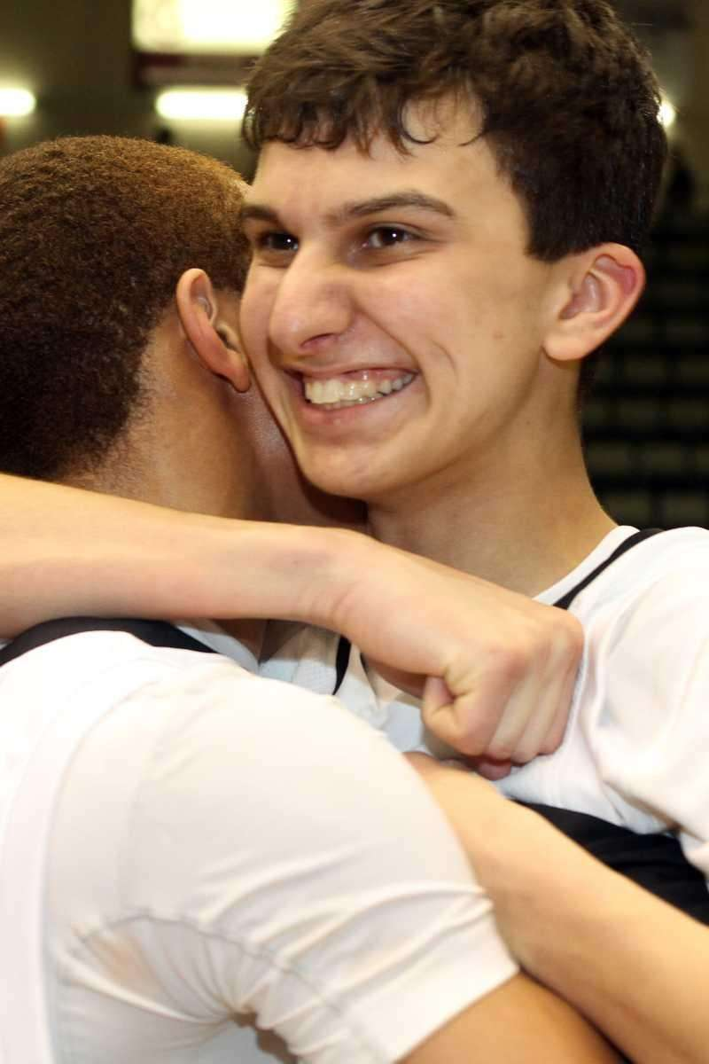 Harborfields' David Ba gets a hug from Kevin